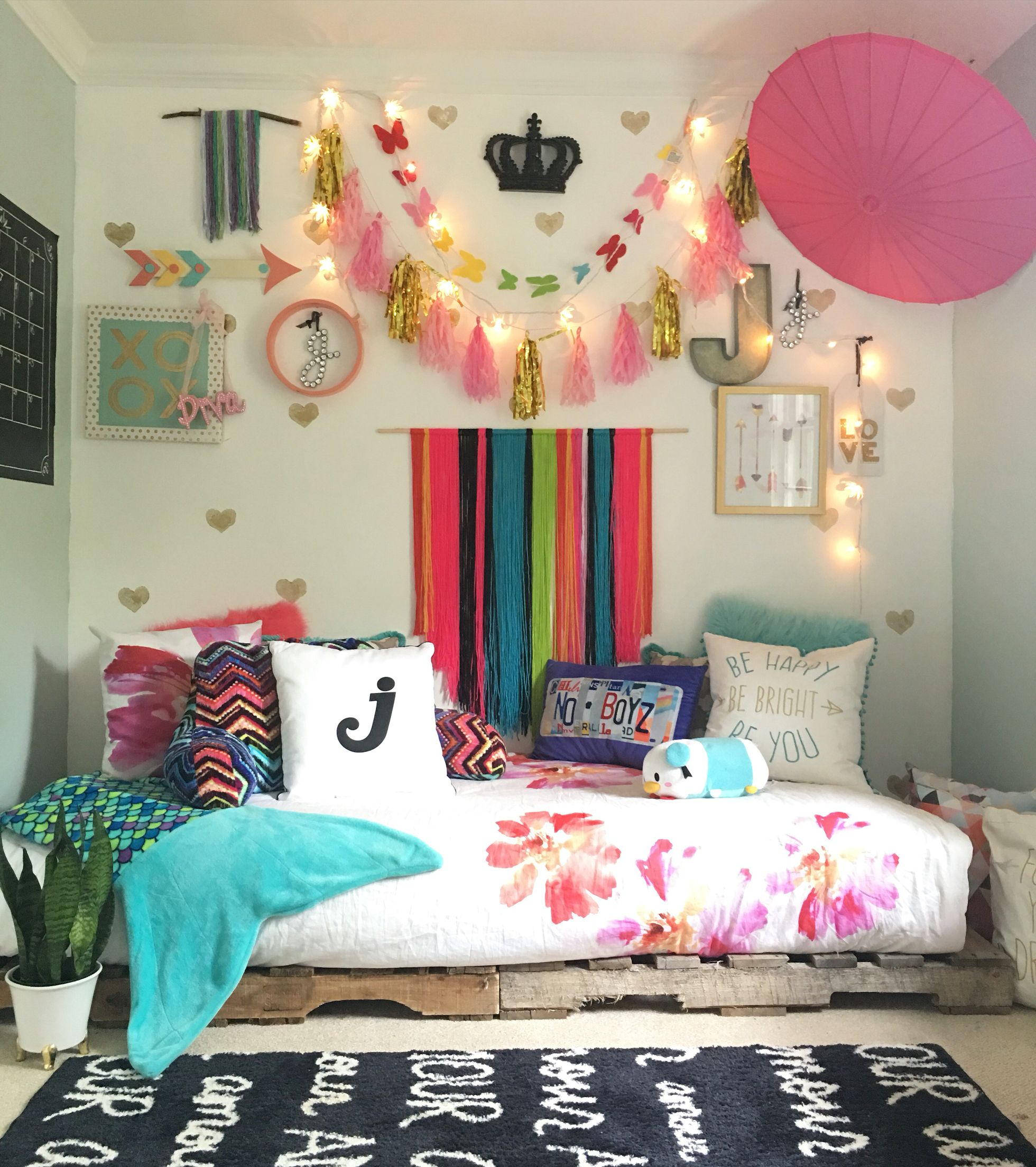 Boho chic tween girls bedroom with pallet bed styled by blissfully