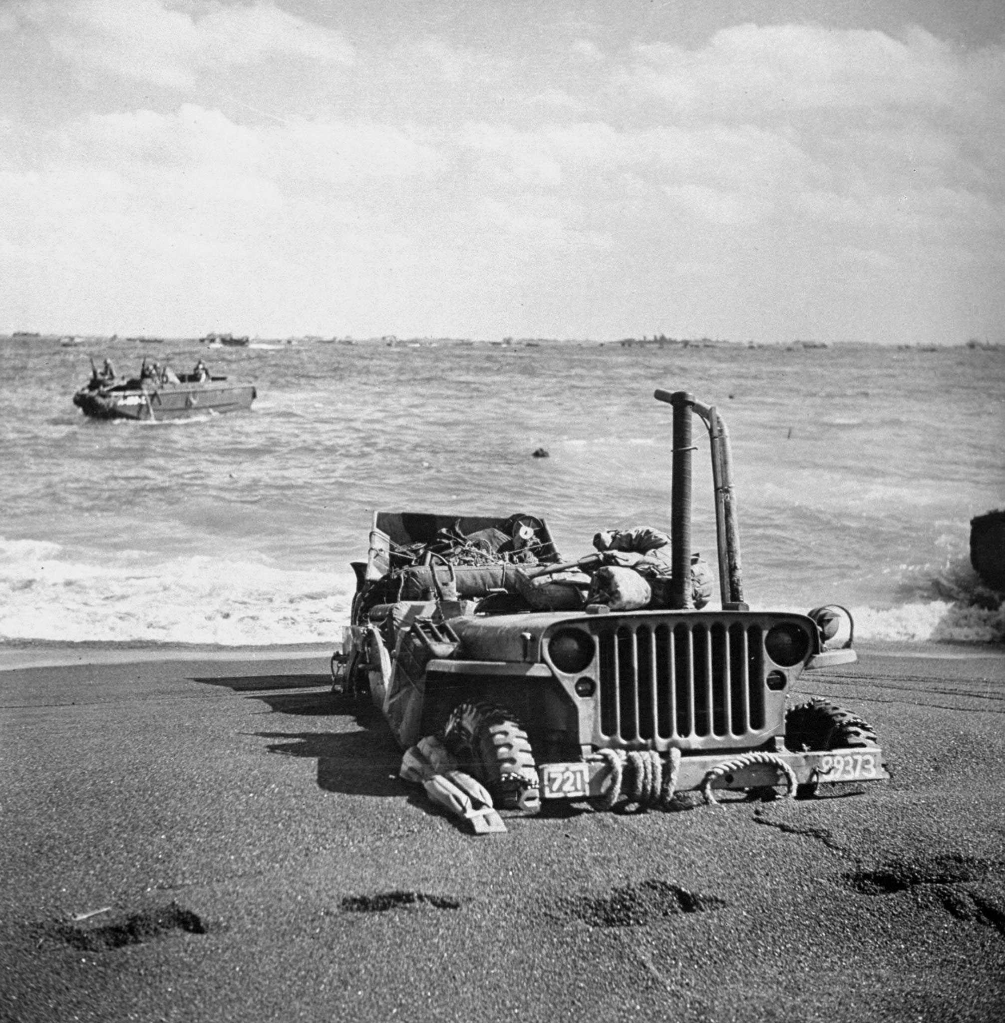 b>Not published in LIFE.</b> Jeep, partially submerged in sand, Iwo Jima,  1945. | Willys jeep, Willys, Iwo