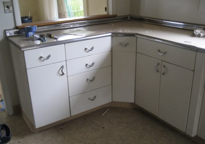 Flat-faced cabinets with L-shaped boomerang drawer pull hardware ...