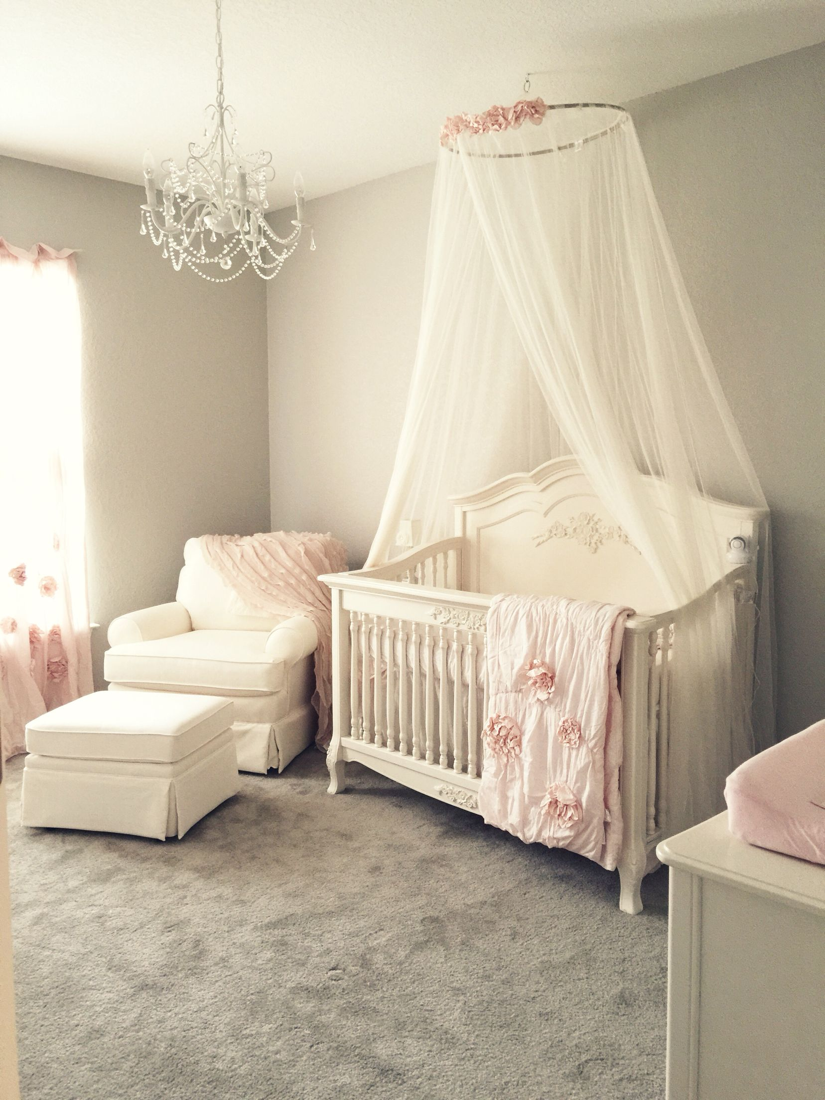 Girly pink blush nursery with chandelier ivory rocker and glider girly pink blush nursery with chandelier ivory rocker and glider ottoman and ivory crib canopy aloadofball Image collections