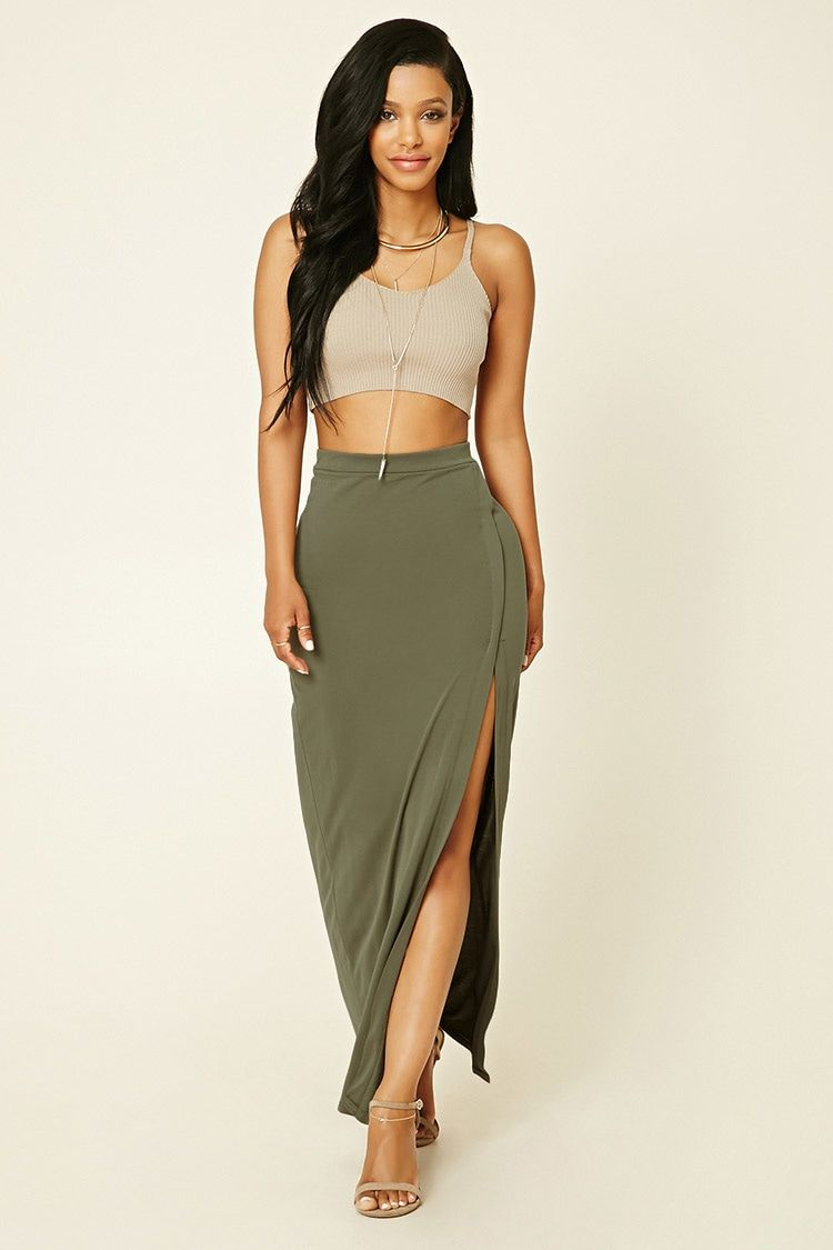A knit maxi skirt featuring a high- slit surplice front and an ...