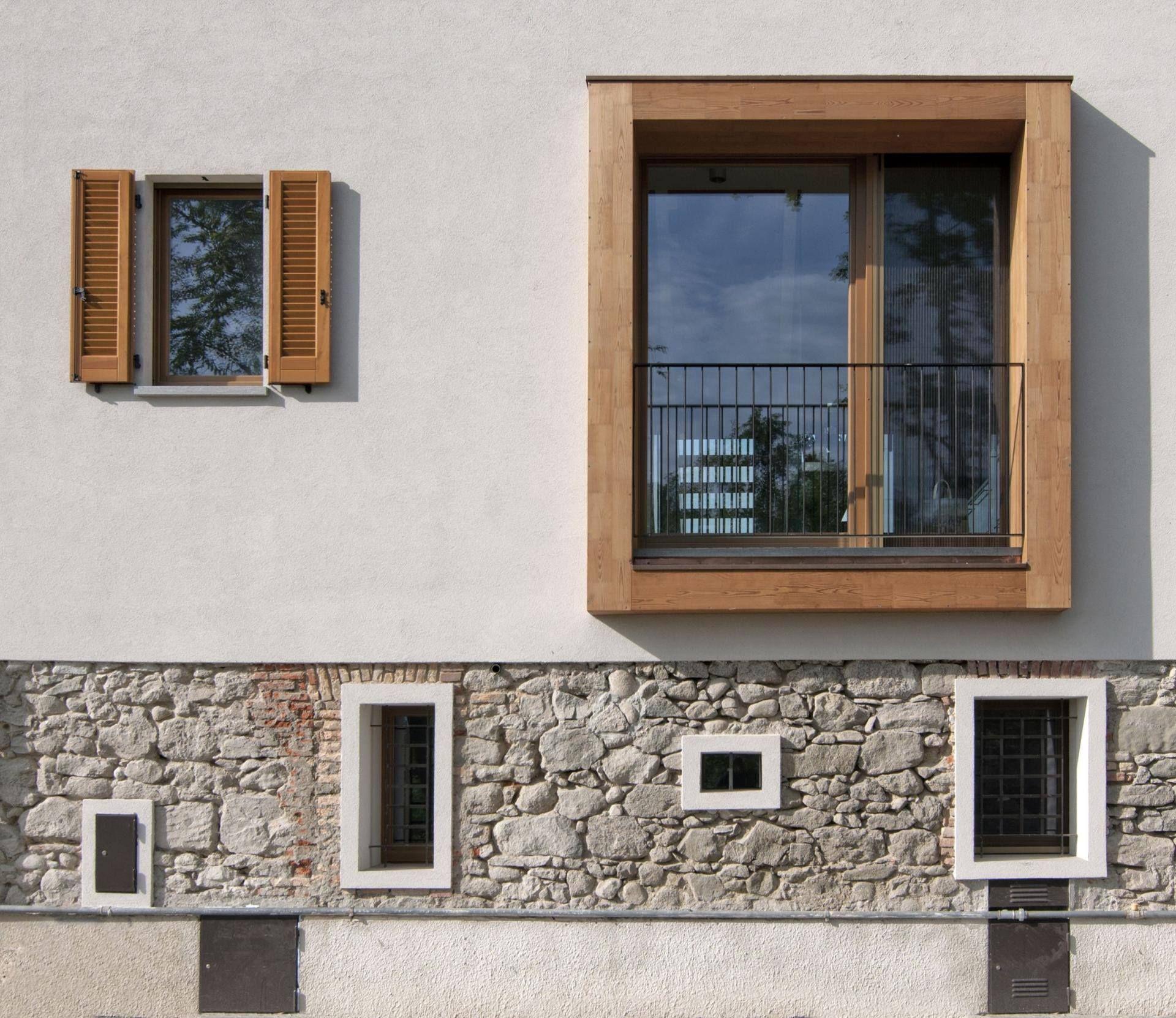 Facciata intonaco pietra mattoni e legno patckwork di for Mattoni e pietra americani