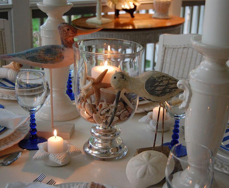 A beach escape table setting shell centerpieces napkin