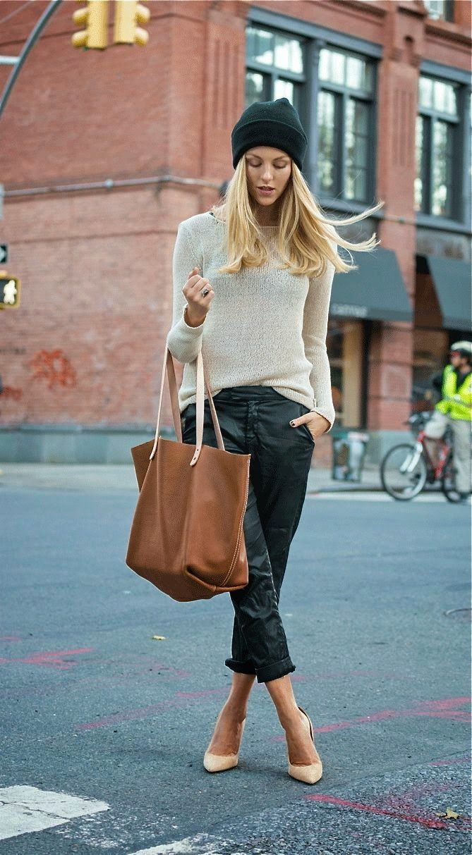 Gorgeous light pastel gray stylish sweater with black shining leather pant and brown leather plan cute hand bag and light yellow high heels pumps and top black warm cap the best street fashion inspiration & looks