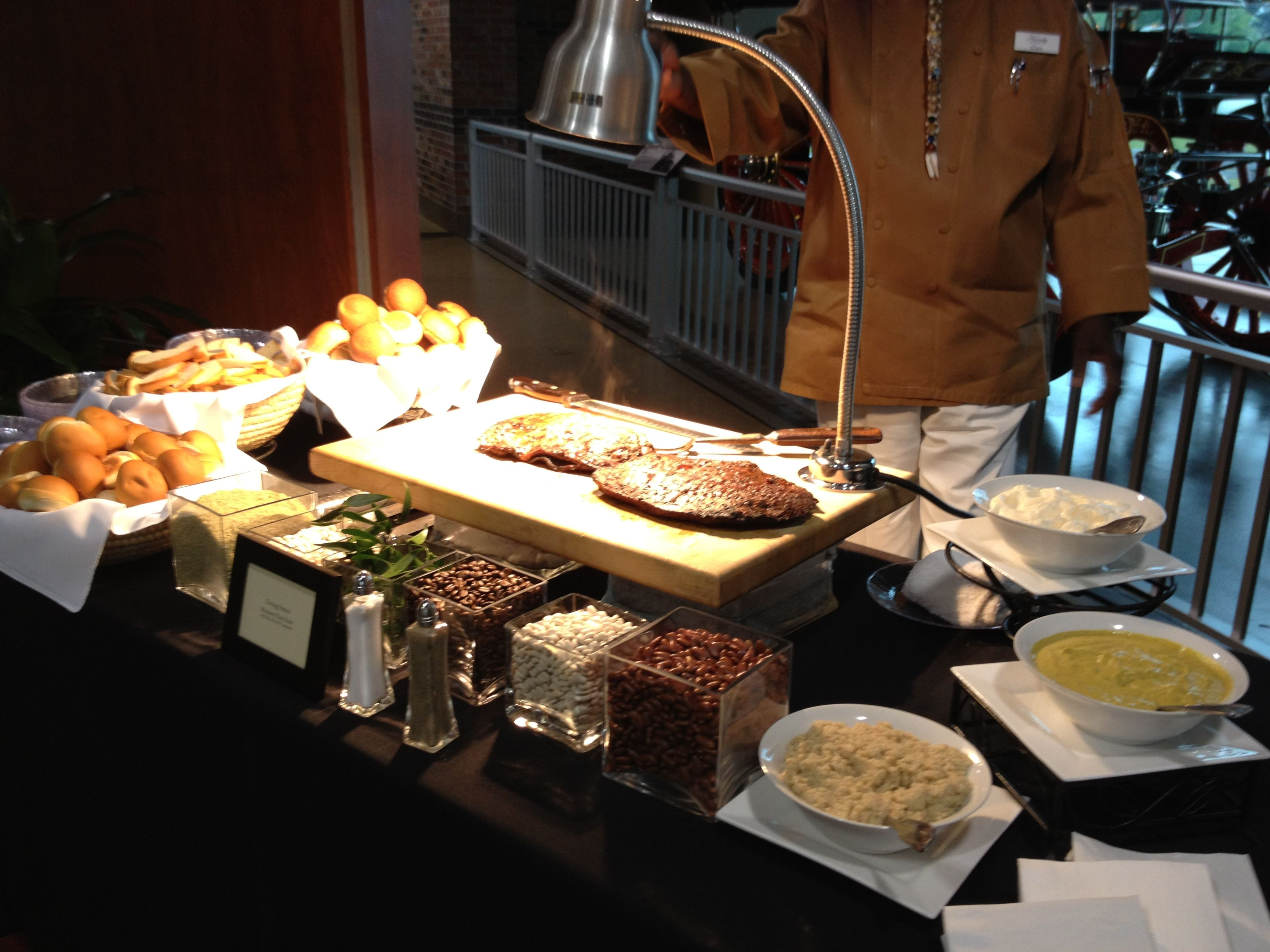 A carving station with flank steak food stations