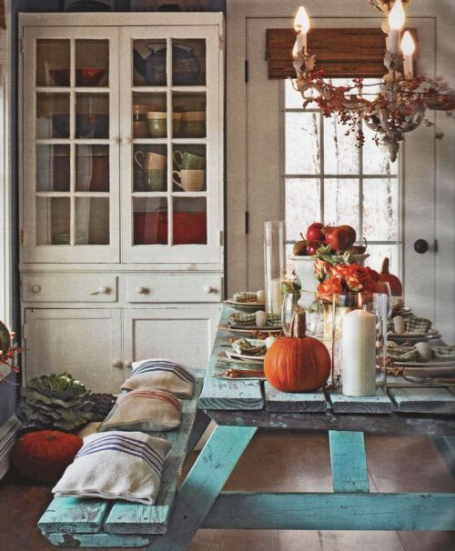 Rustic cottage fall tablescape with a distressed teal picnic table and cute striped pillows for cushions