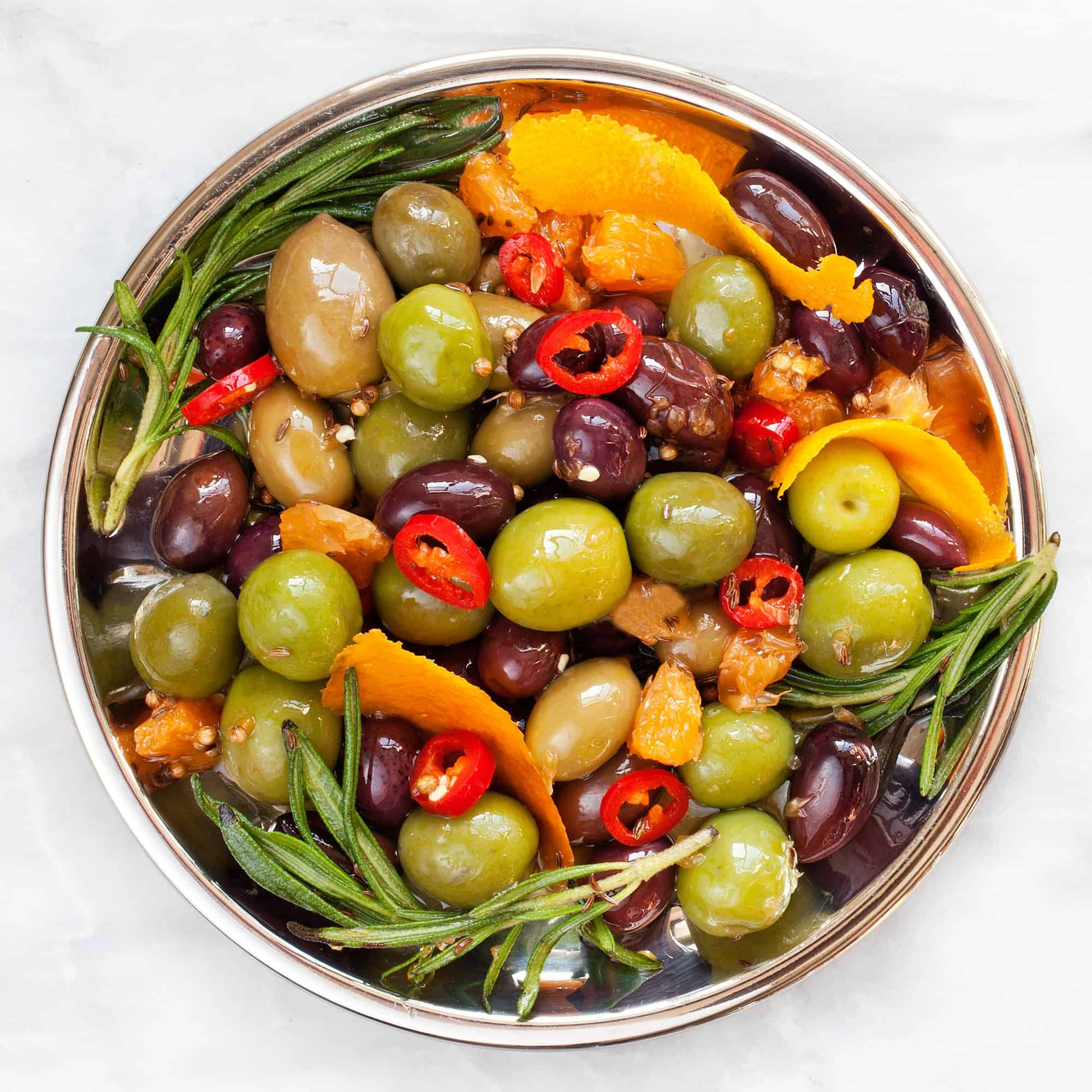 Citrus Marinated Olives With Chilies And Rosemary Last Ingredient Recipe Marinated Olives Olive Snack Whole Food Diet