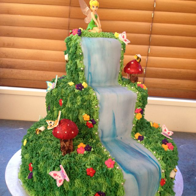 Tinkerbell cake.... do one side winter, the other summer with Tink ...