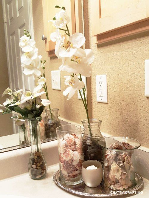 Spa bathroom on a budget beach themed bathrooms silver for Bathroom decor dollar tree