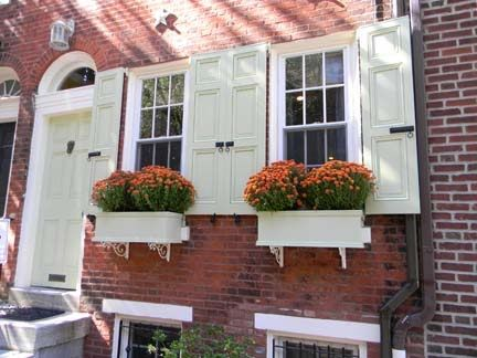 Red Brick House With Shutters White Trim