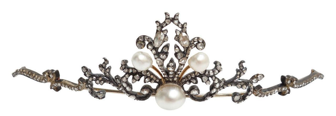A diamond and baroque pearl tiara brooch combination, 1890. With two branches of foliate scrolls either side of a central motif of five pearls in various shapes.