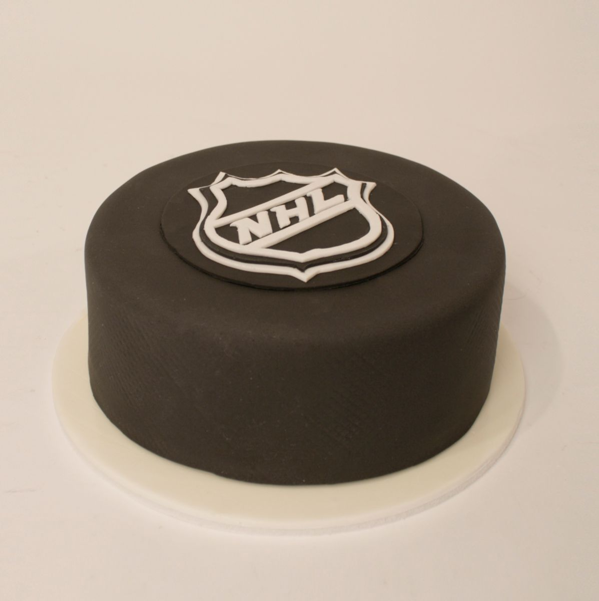 Charm City Cakes hockey puck cake Sweet Sweet Hockey