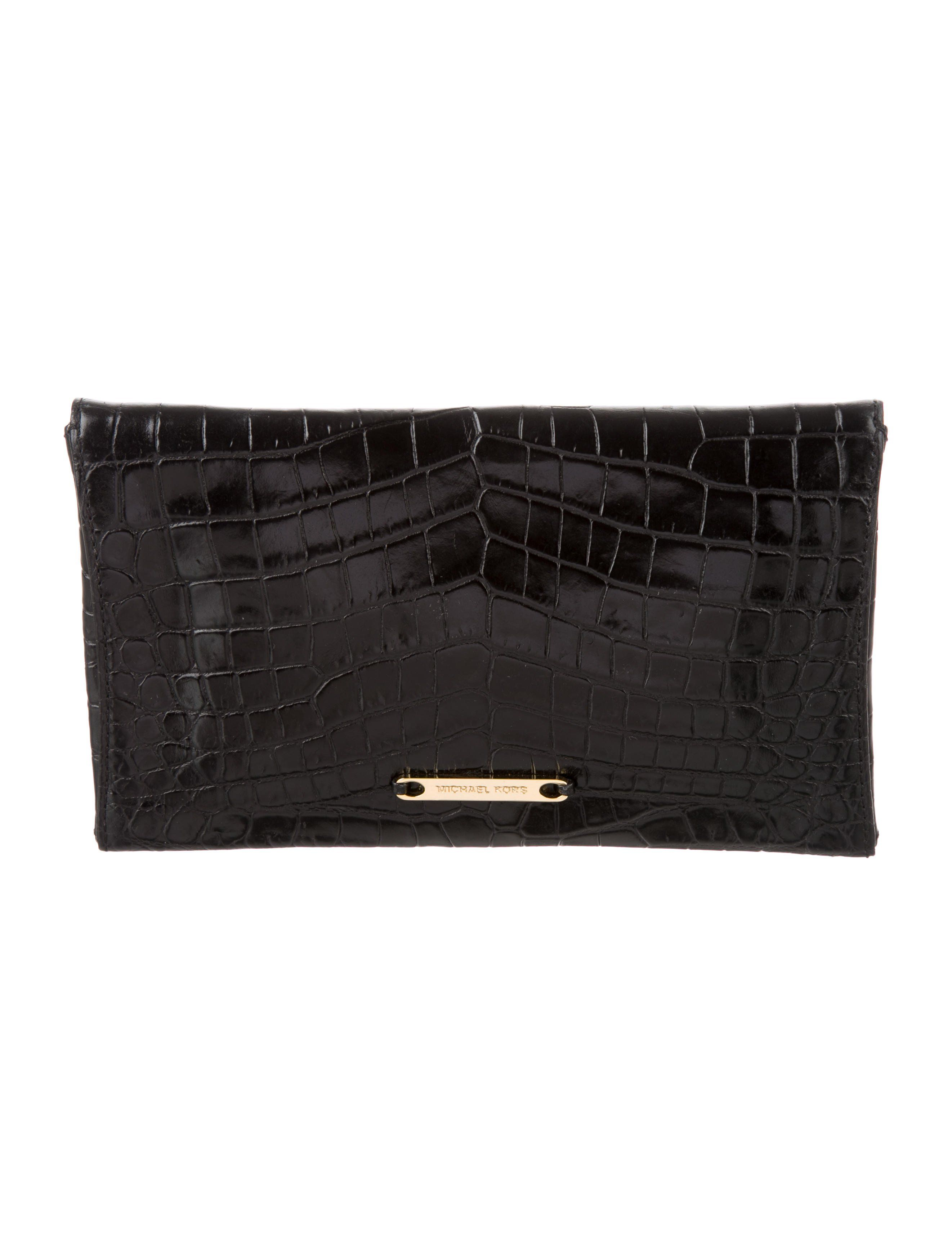 a223238be5cb Black embossed Michael Kors clutch with gold-tone hardware, logo placard at  back, metallic gold-tone leather interior, single slit pocket at interior  wall a