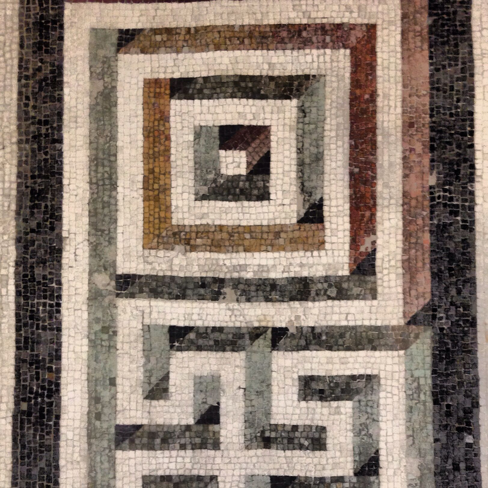 A Spiral Roman Mosaic Pattern In Red Orange Blue And