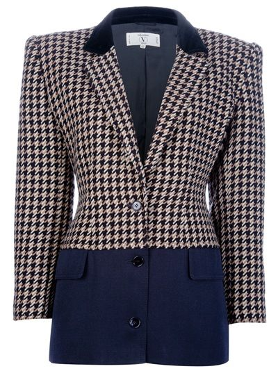 Brown wool dogtooth jacket from Valentino Vintage featuring a notched lapel with a contrasting black collar, long sleeves with a buttoned cuff, a buttoned closure to the front, a black panel starting at the hips and two flapped pockets towards the bottom. Please note that vintage items are not new and therefore might have minor imperfections.