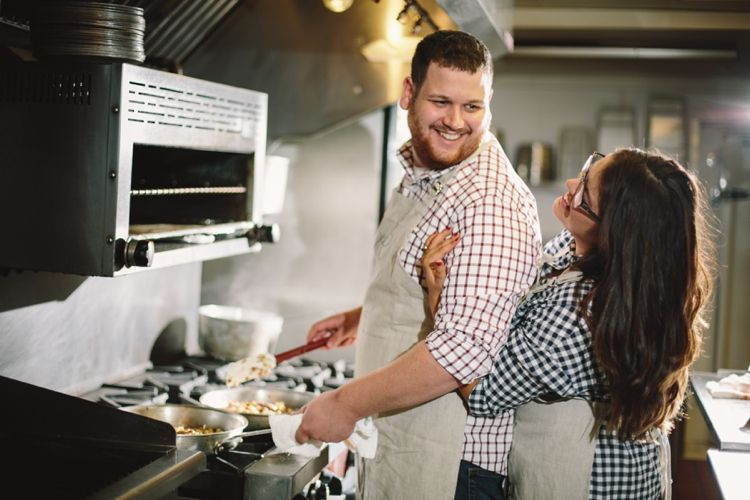 A Chef's Cooking Engagement Shoot is part of cooking Couple Engagement Shoots - Engagement shoots are a great way to prepare for your wedding portraits  You not only get to know your photographer but it enables you to feel at ease in front of the lens together  It can be tricky to think of a location or concept for a portrait style shoot, but if you choose something you will feel relaxed doing it can create wonderful results  Dean is a chef and so he cooked up a breakfast for fiancée Shelby, which was all perfectly captured by their photographer Jennifer Van Elk Photography   Shelby walked up behind Dean while he was busy at the stove cooking a sumptuous breakfast hash  She wrapped her arms around, holding him while he cooked  He smiled as he turned to look at his beautiful fiancée  This was one of the most loving and gorgeous scenes I have captured  I was so happy to have the opportunity to work with Shelby and Dean and to be able to capture some candid shots of them cooking together at Meridian Restaurant & Bar, the restaurant where Dean is the