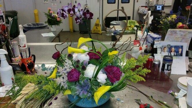 Artsy arrangement with mini calla kale peonys solid aster and allium