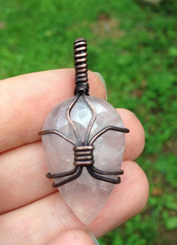 Photo of Rose Quartz crystal wire wrap pendant wrapped in oxidized copper with faux leather cord – Sch…
