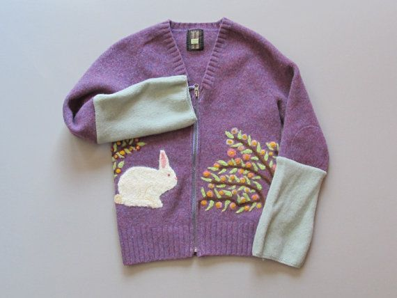 This incredible sweater began as an adults recycled v-neck pullover that was machine felted. Then the artist at Screen Door Studios needle