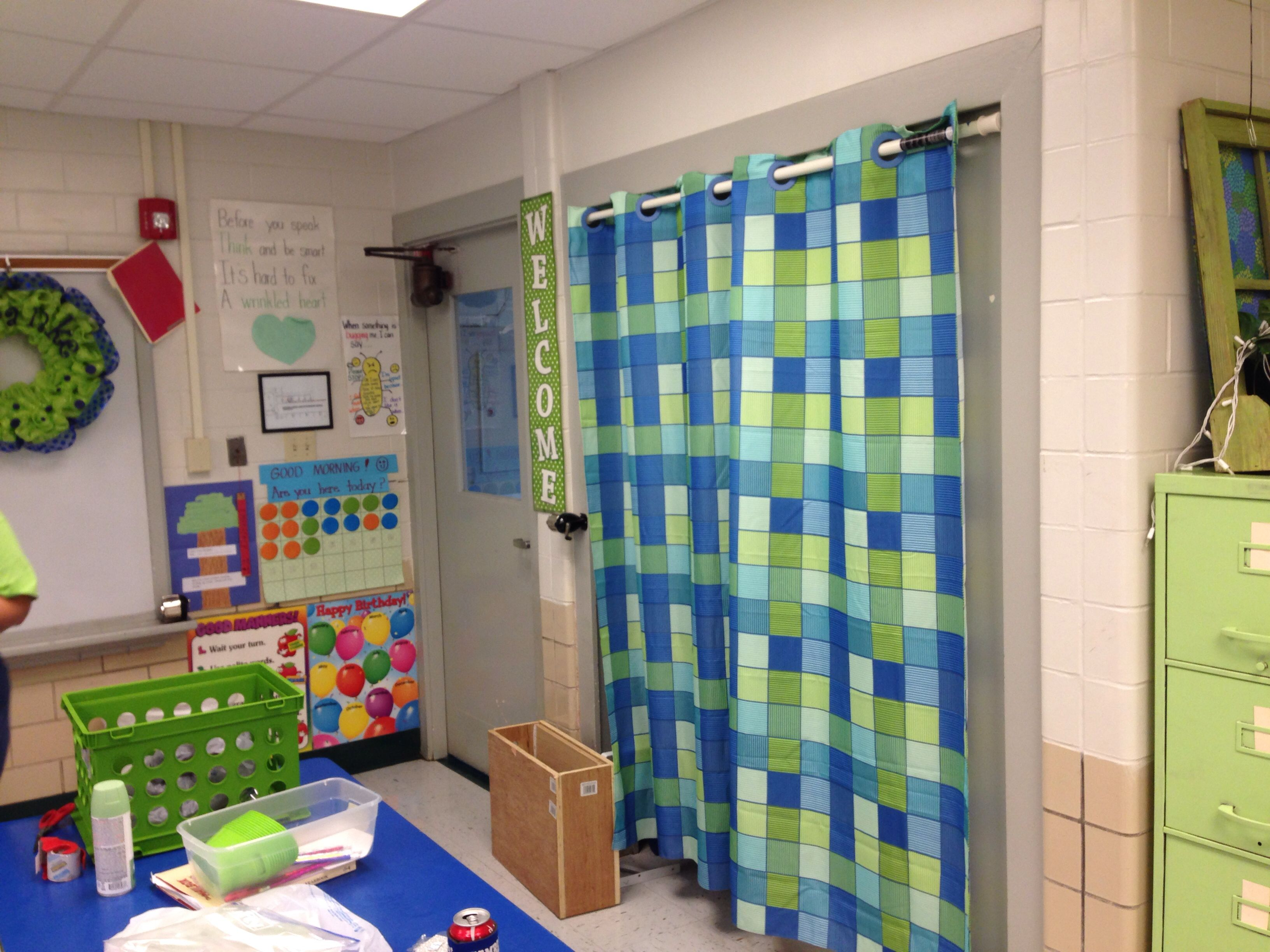 I covered my closet door in my classroom with a shower curtain.