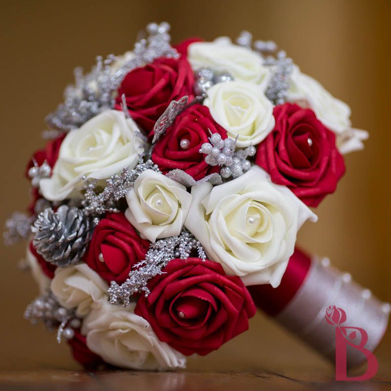 Red and cream holiday wedding bouquet with silver glitter for Red wedding flower ideas