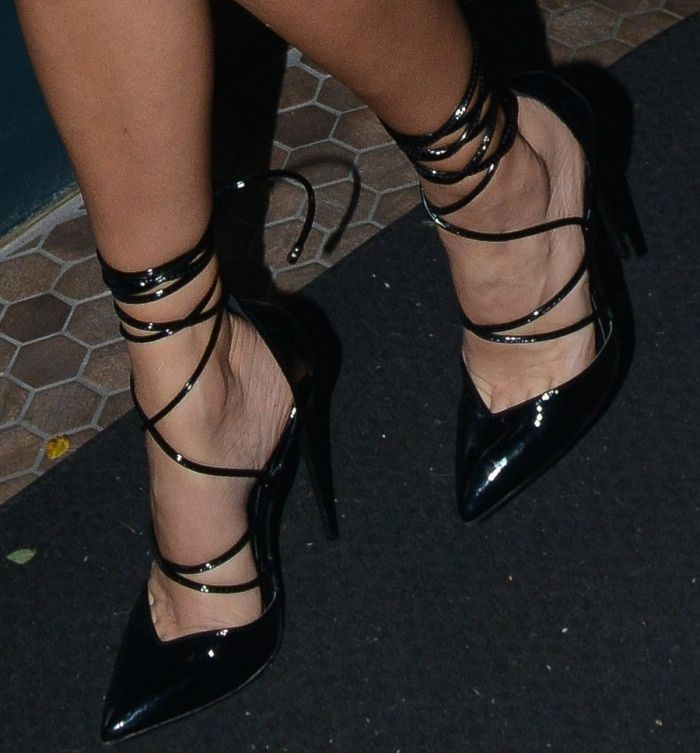 bb032742b47 Kourtney Kardashian wearing black pointed patent stiletto heels from her  own collection at her PrettyLittleThing party in Los Angeles