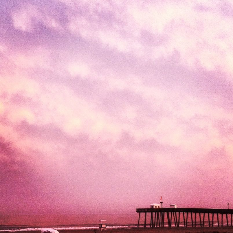 pink sky on the beach over the fisherman's pier in Ocean City... Beautiful!