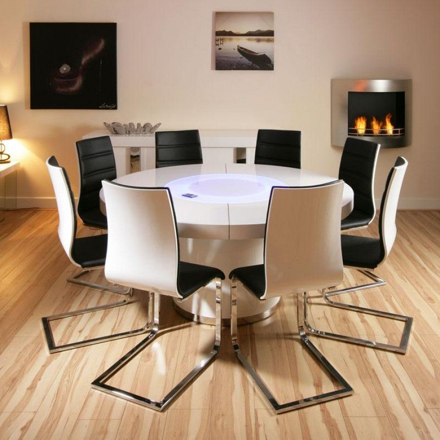 Large round white gloss dining table and 8 white/black dining ...