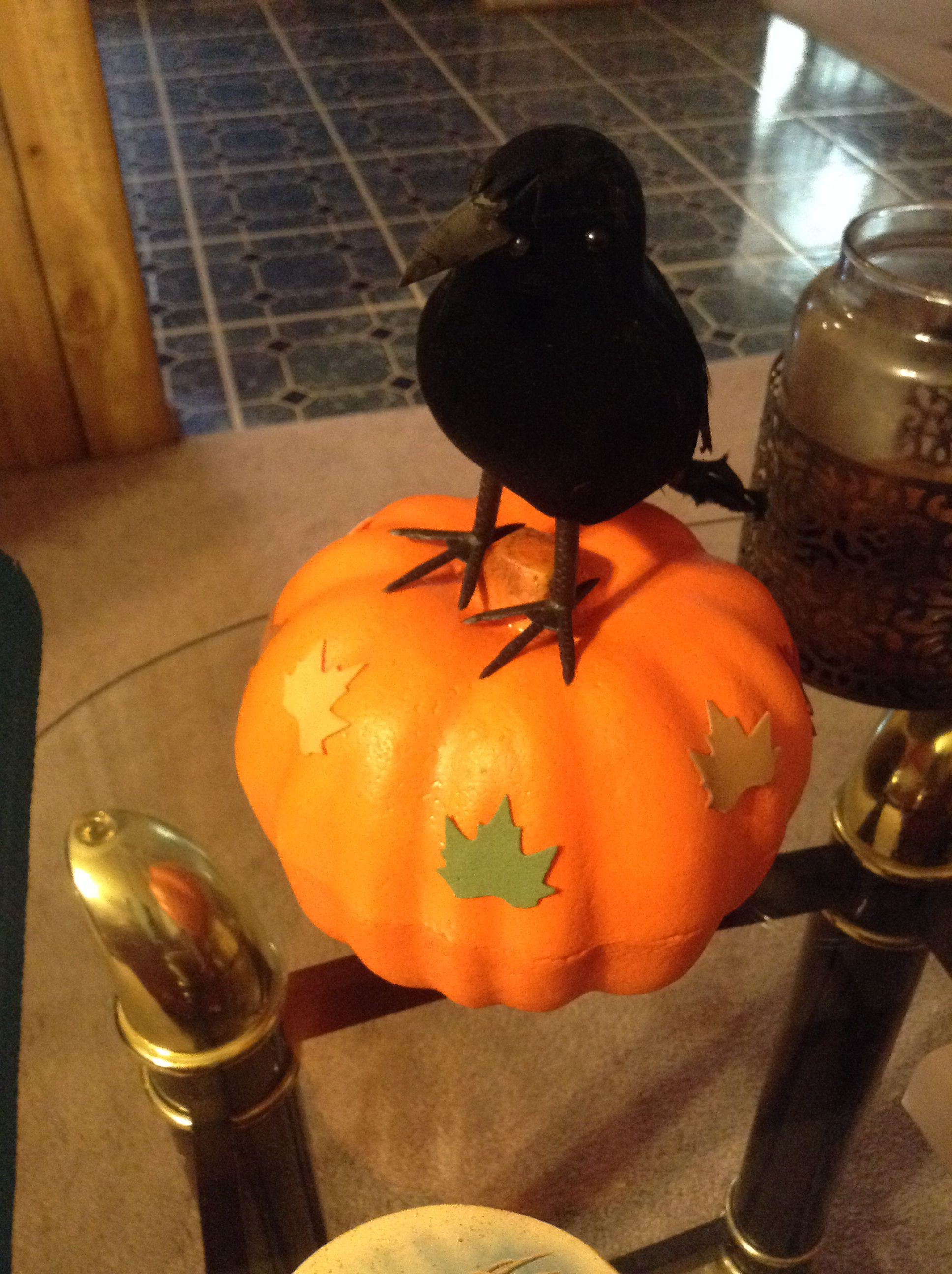 Buy a plastic pumpkin and then buy a black crow and then buy little plastic leaves with the sticky on the back. I just love this Halloween craft! So fun and creative for family time and really safe and easy for children!