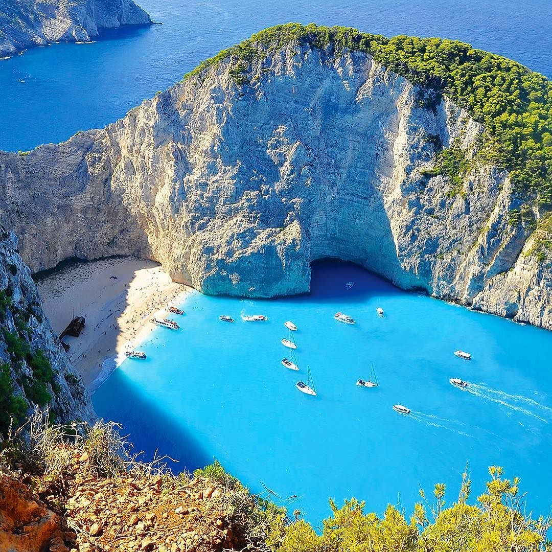 On the island of #Zakynthos youll find Navagio Beach  also known as Shipwreck Beach or Smugglers Cove in reference to its often colorful past. Bounded on either side by steep cliffs the beach offers crystalline waters and perfect white sands. There are no roads in so book a boat tour on TripAdvisor and head for Navagio Beach!