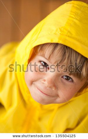 792afc106 Smiling little child in raincoat outdoors - stock photo