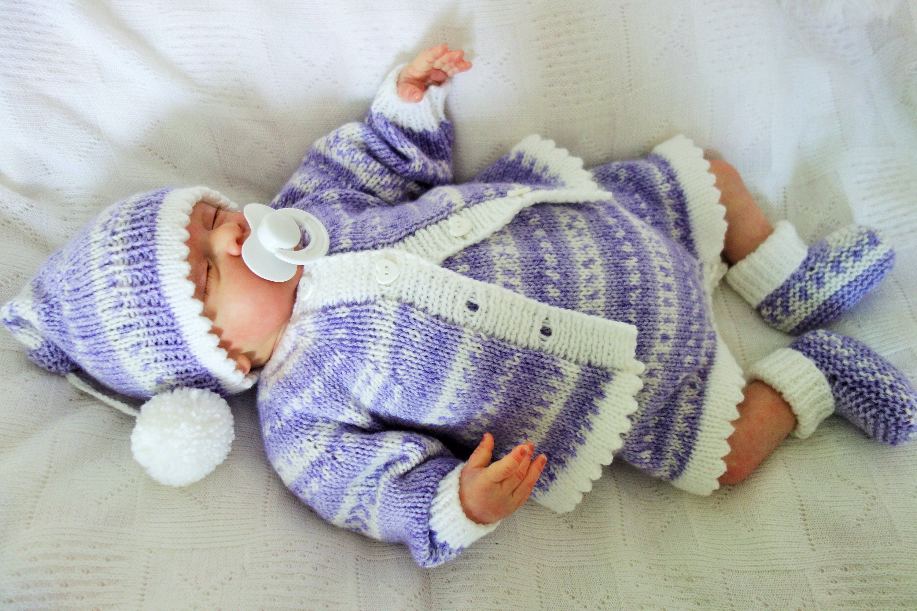 62211f700276 Hand knitted baby romper
