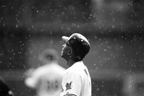 Milwaukee Brewers' Nyjer Morgan looks up into the rain during the 1st inning of a baseball game against the Philadelphia Phillies, Sunday, Aug. 19, 2012, in Milwaukee. (Original photo by Tom Lynn/AP)