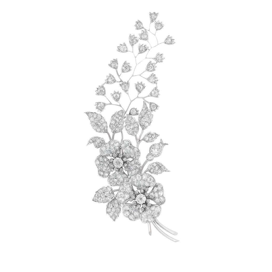 Antique Diamond Corsage Brooch  Rhodium-plated silver, gold, the large curving corsage composed of two flowers amongst climbing leaves and branches, enhanced by 3 old-mine cut diamonds approximately 2.00 cts., set throughout with 197 old-mine cut diamonds approximately 13.00 cts., accented by 32 small rose-cut diamonds, approximately 30 dwt.