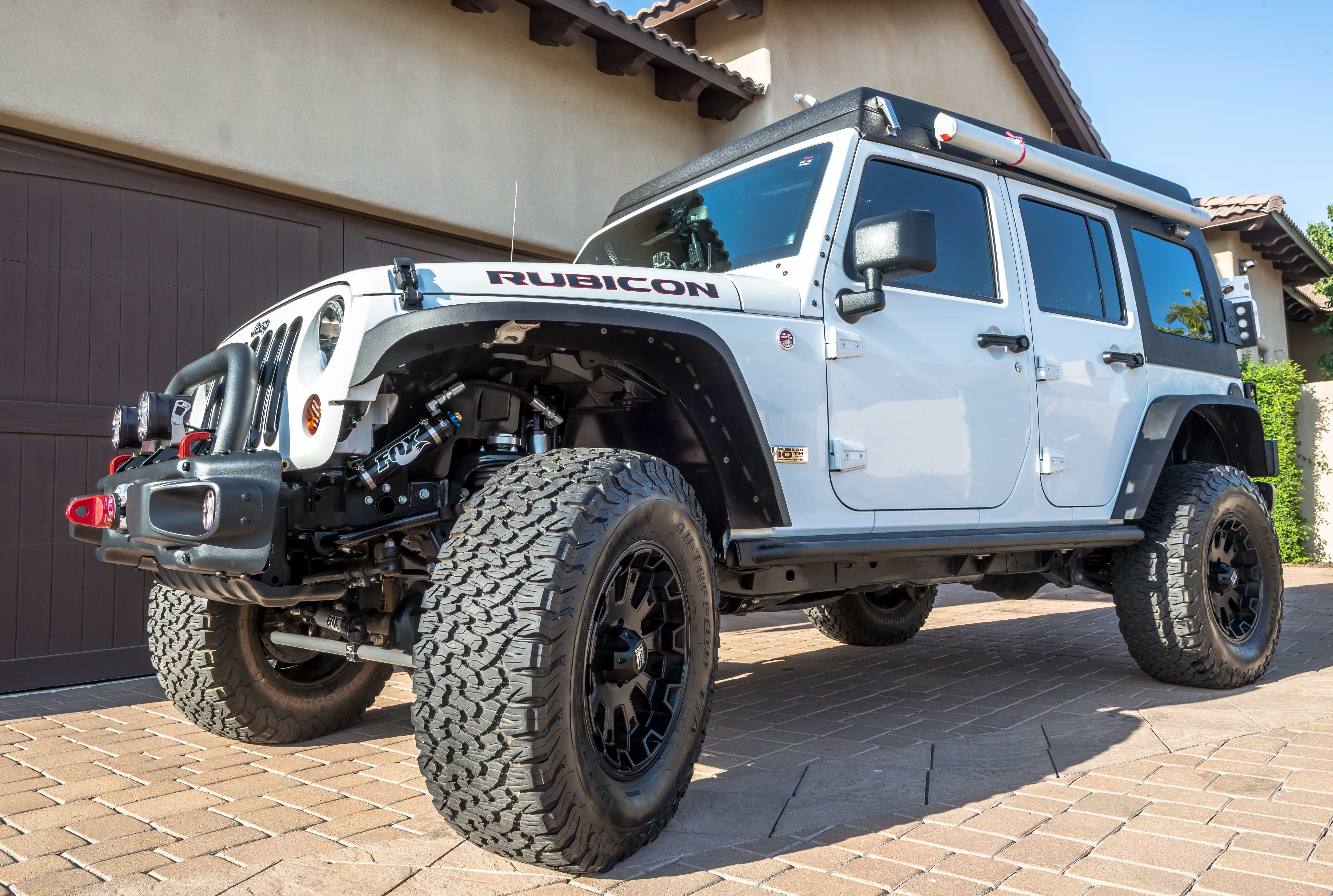 This 10th anniversary wrangler unlimited rubicon edition has 35 bfgoodrich tires km2 tires spidertrax off road wheel spacers 3 5 american exped