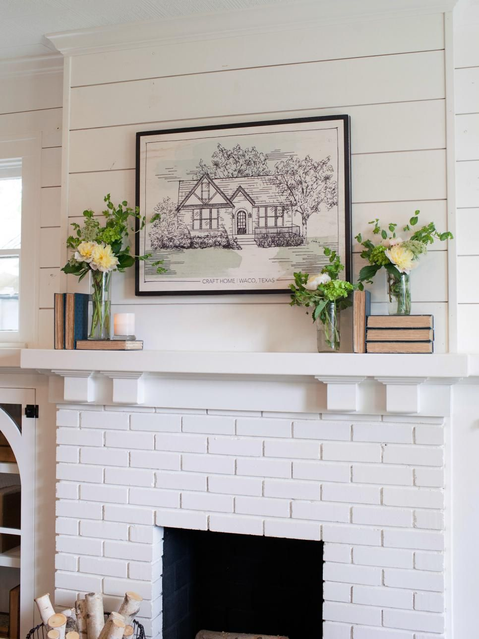 The Brick Fireplace Wood Mantel And Shiplap Are Painted In Bright White Which Offers A Striking Balance With Dark Stained Floors Blue Gray Walls