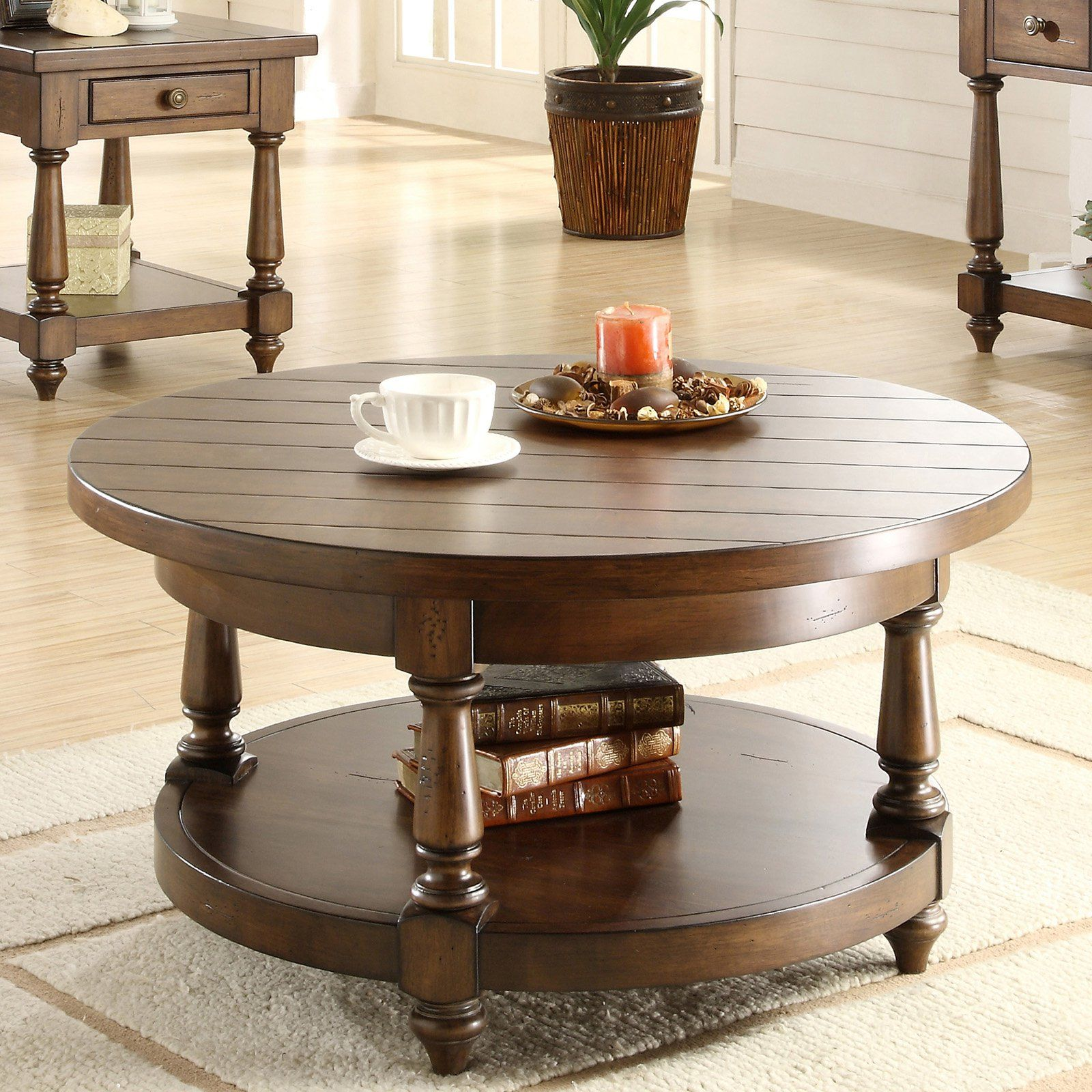 Riverside Newburgh Round Cocktail Table Antique Ginger Casual Yet Refined The Riverside Newburgh Round Coffee Table Round Coffee Table Riverside Furniture [ 1600 x 1600 Pixel ]