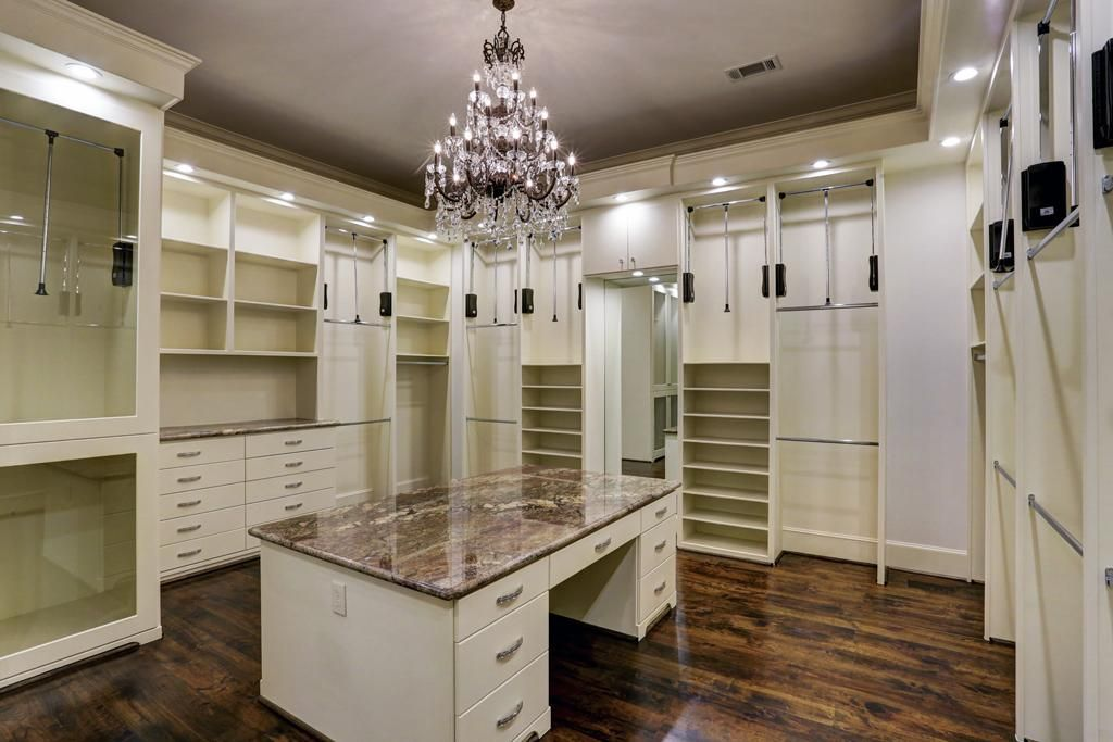 Master walk in closet 1 with seated granite countertop packing master walk in closet with seated granite countertop packing station pull downs and chandelier aloadofball Image collections