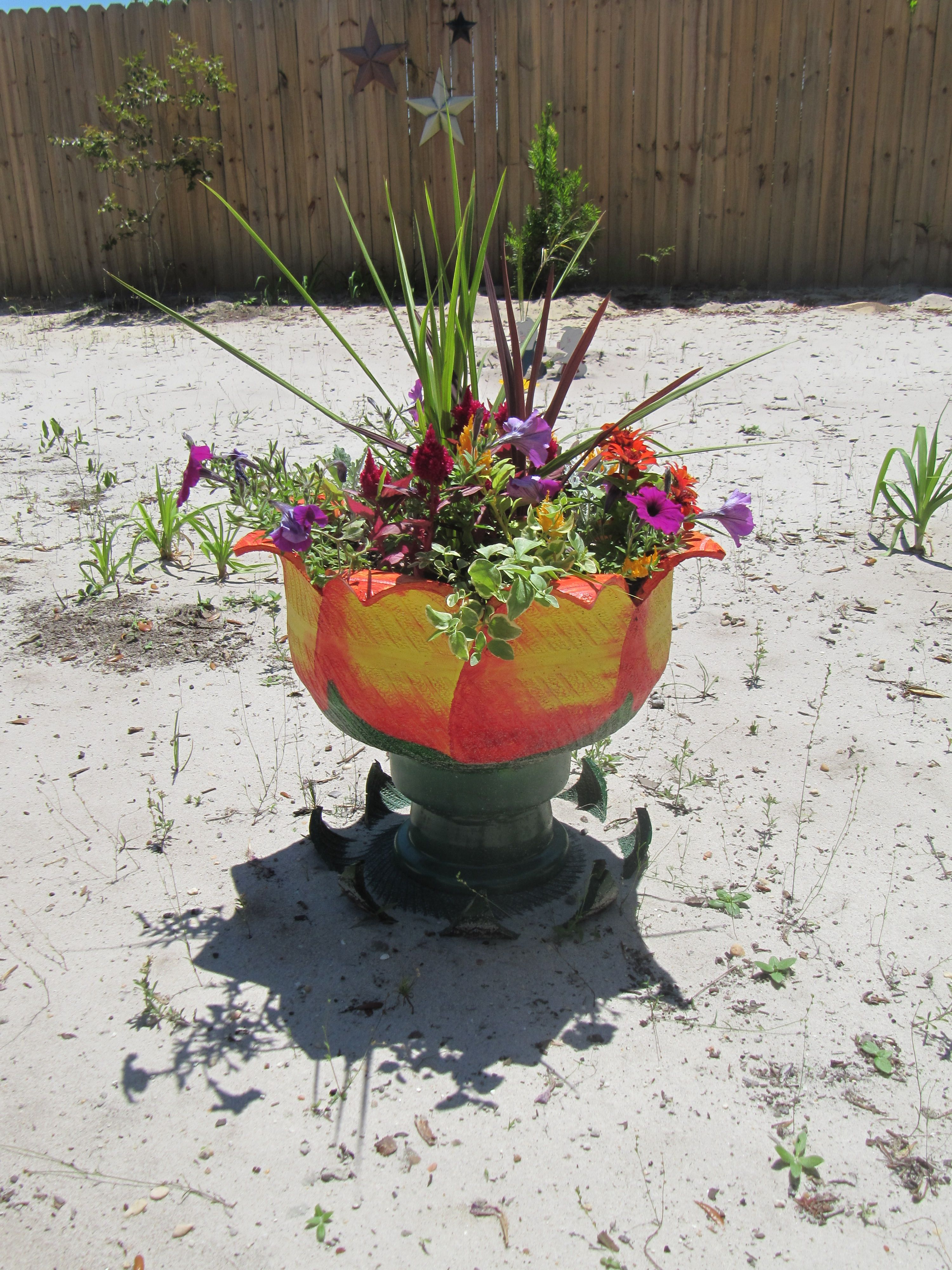 Bon Planter Made From A Recycled Golf Cart Tire. Nice Color!