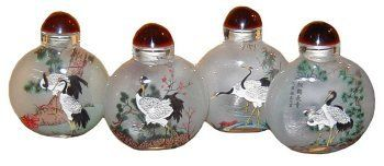Chinese Four Seasons cranes glass snuff bottles - reverse painted by Reorient. $19.95. Made in China. Ships in brocade box. Meticulously reverse painted by hand. Set of 4 glass snuff bottles. The art of reverse painting on glass is among China's most ancient art forms.  It is a painstaking technique that demands that the minutest details be applied before the broadest strokes.  Placing the artwork on the inside of small bottles makes the workmanship all the more intri...