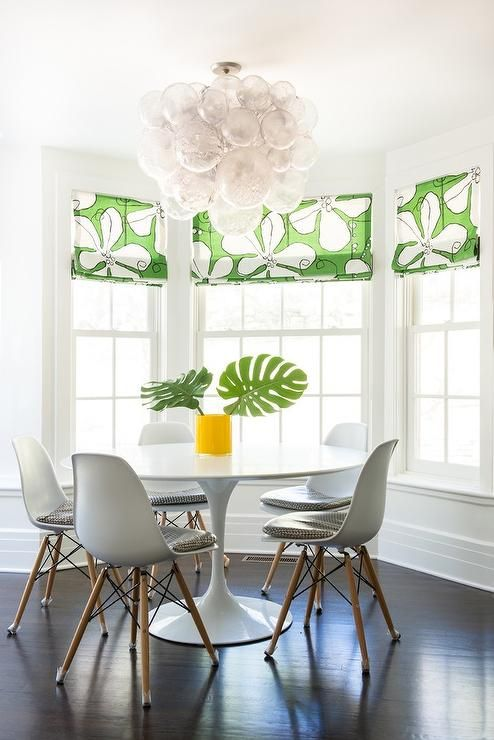 Stunning Contemporary Dining Room Features An Eye Catching Oly Studio Muriel Chandelier Hung Over A