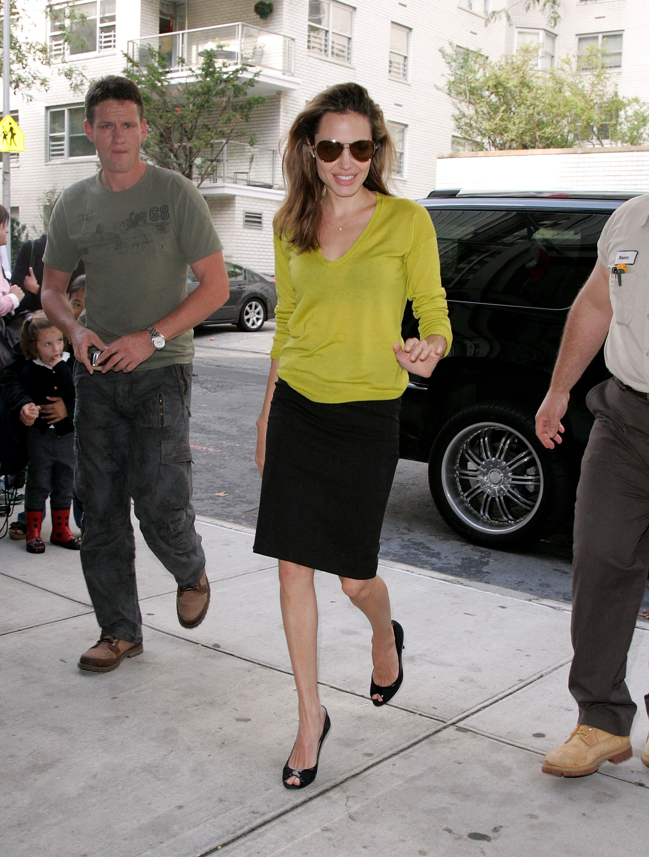 2856d96018 Angelina Jolie and Brad Pitt Have a Fashion Moment Every Couple Can Relate  To