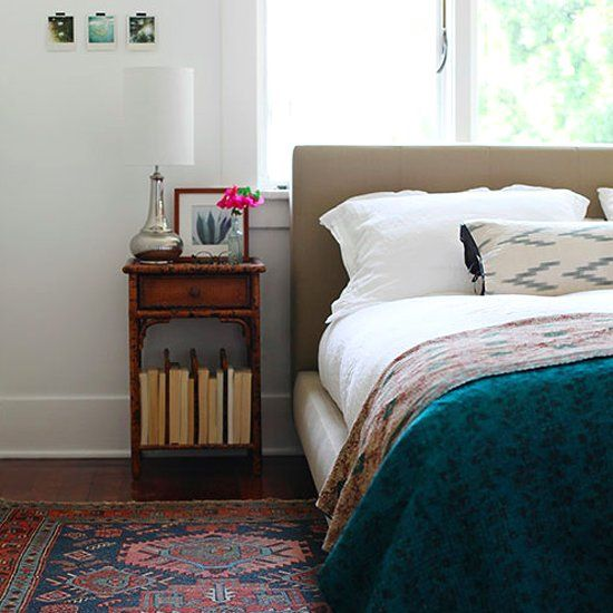 Simple bedroom decorating ideas that focus on the main pieces in the space (bedding, curtains, rugs, etc.) (image by Design Sponge)