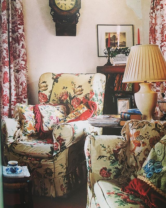 """A corner of the sitting room in our old Suffolk cottage . The curtains are """"L'Offrande a l'Amour"""" toile de Jouy. The sofa and armchair have been in all our childhood homes. Sadly it is too large for where my mother now lives, but it's still in the family with my brother. It is nothing special except that it had """"always been there"""" ... Cushions are Victorian crewel and needlepoint. #christophermoorefabrics #christophermooreathome"""