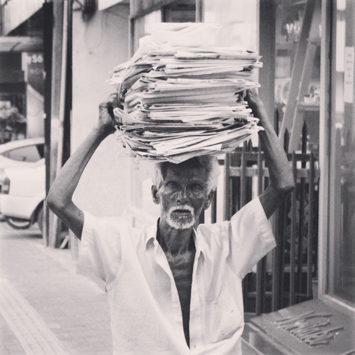 A old man and his newspapers in Colombo