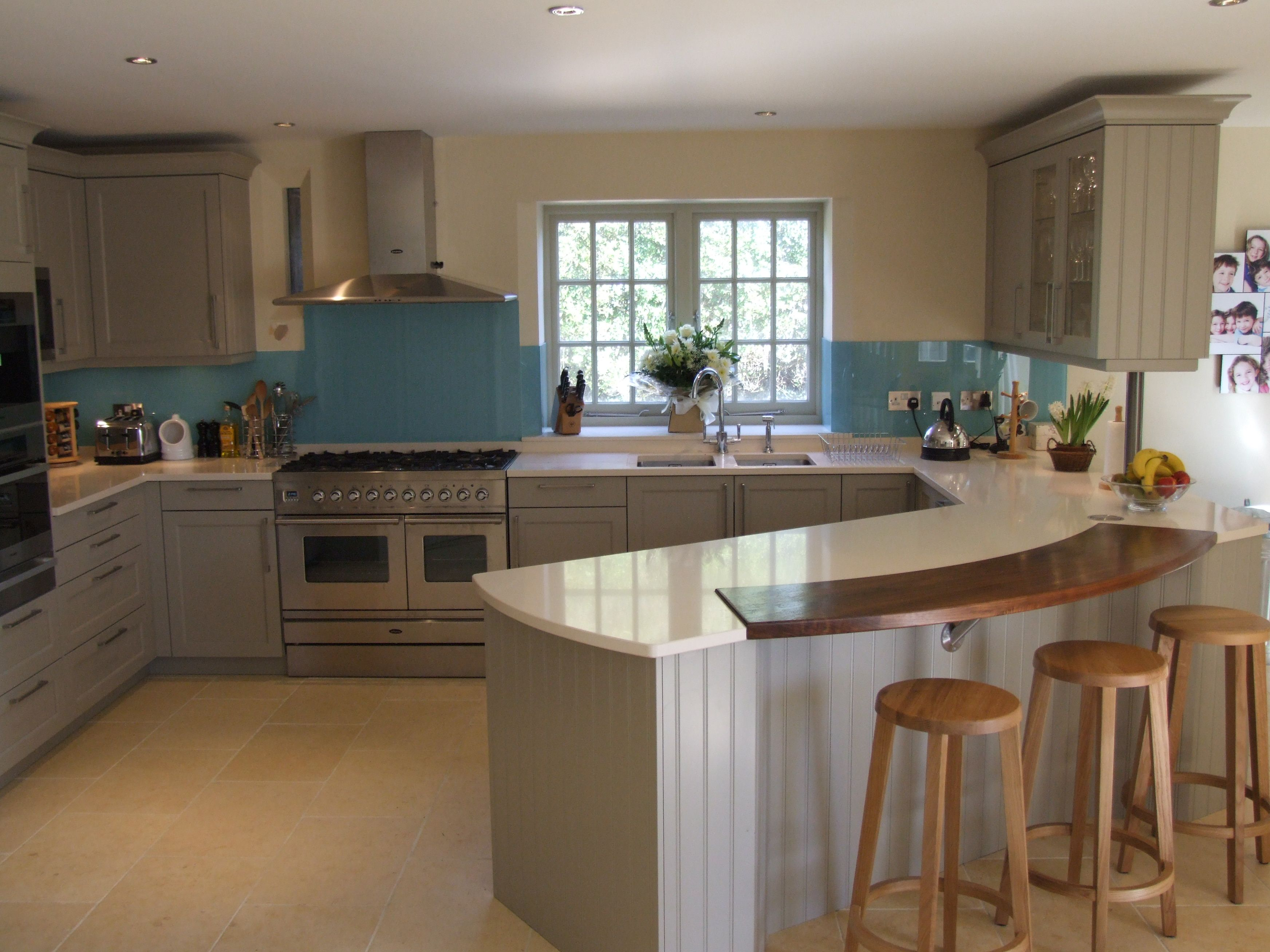 Sussex Designer Kitchens. Ice blue adds a bright colour burst to this otherwise traditional kitchen  Glass