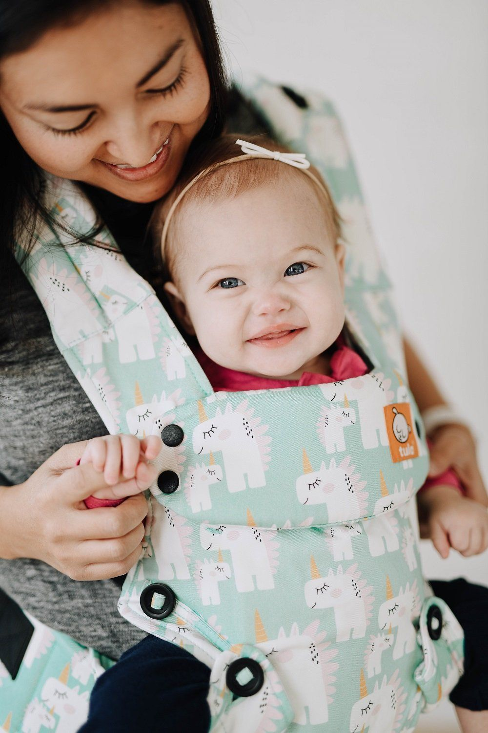 529df8e834a Unisaurus - Tula Explore Baby Carrier - Baby Tula. Meet sweet little  buddies from a