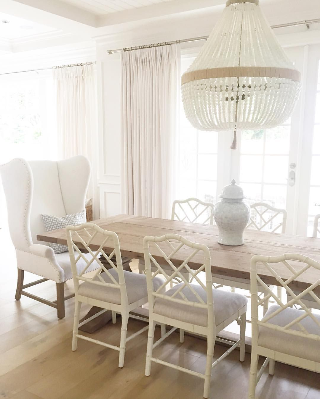 hanging capiz chandelier illuminating a salvaged wood trestle ballard design dayna chairs ro sham beaux restoration hardware benjamin moore ballard design chairs