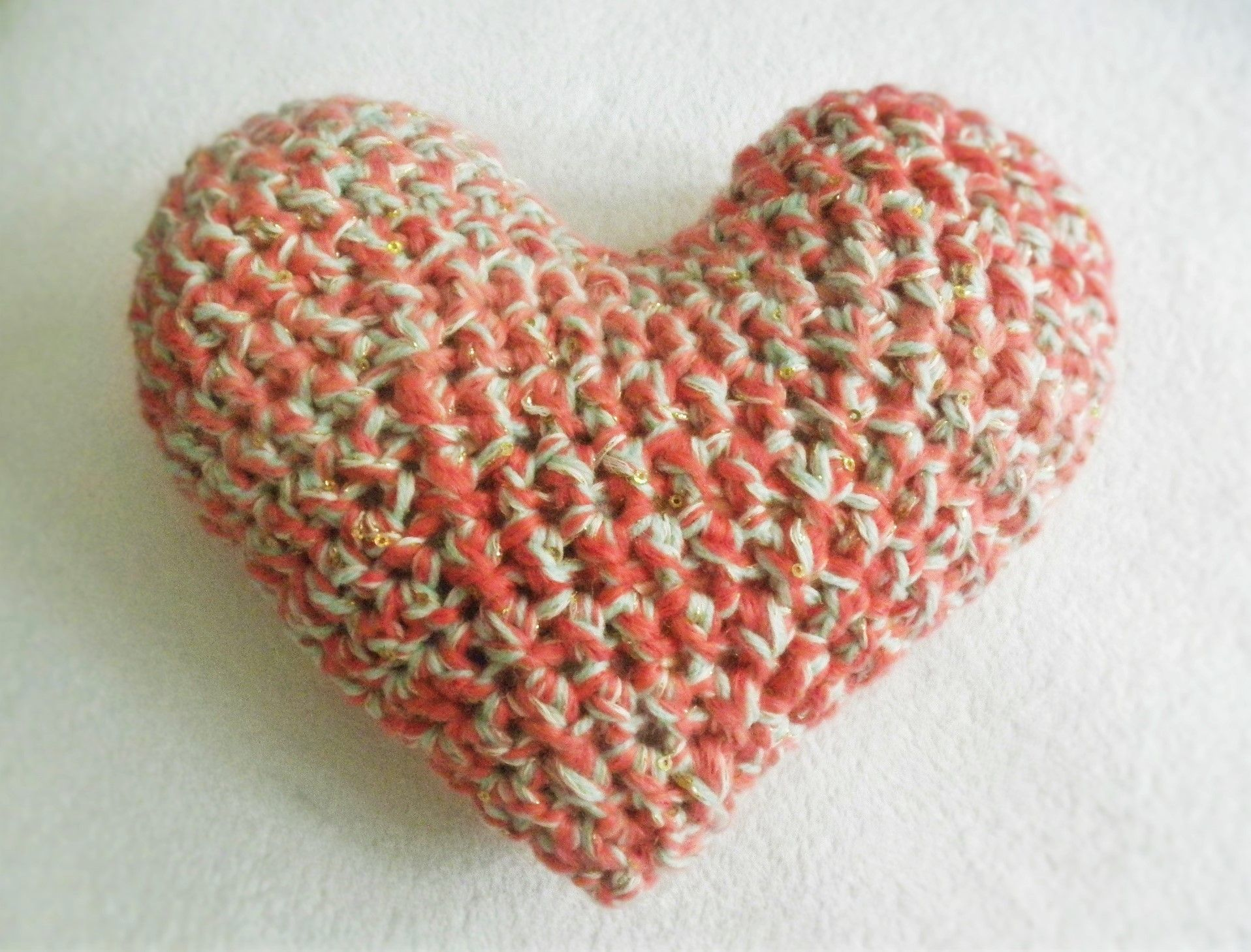 This Crochet Sparkle Heart Pillow is a cute accent for the baby's crib or nursery decor