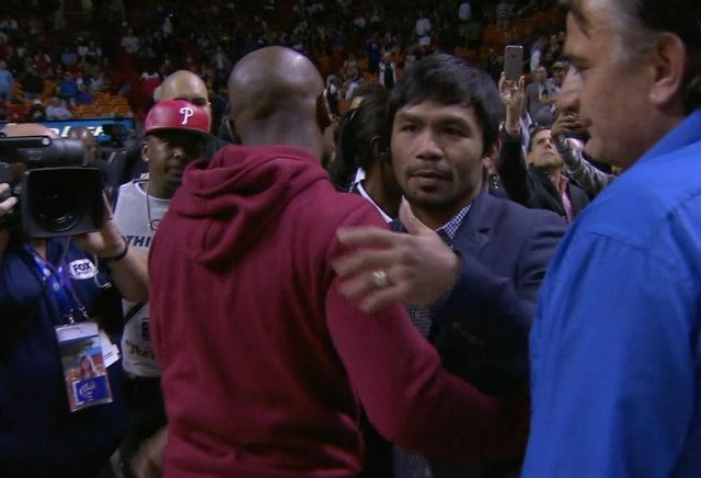 Manny Pacquiao and rival Floyd Mayweather Jr. have finally met, not in the ring, but at courtside Miami Heat and Milwaukee Bucks game at the American Airlines Arena on Tuesday.